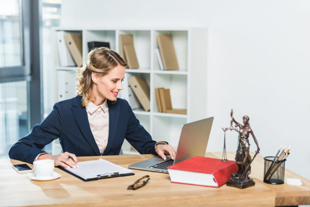 paralegal woman looking at laptop