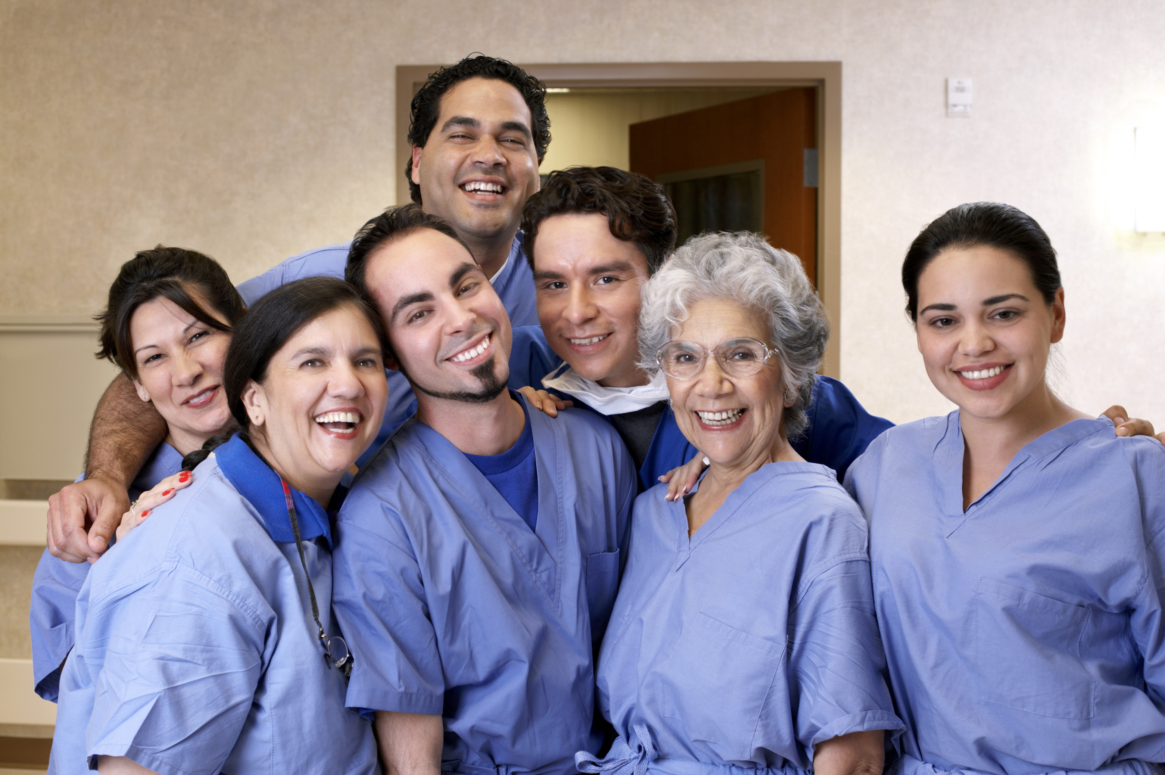 group of male and female nurses in blue uniform