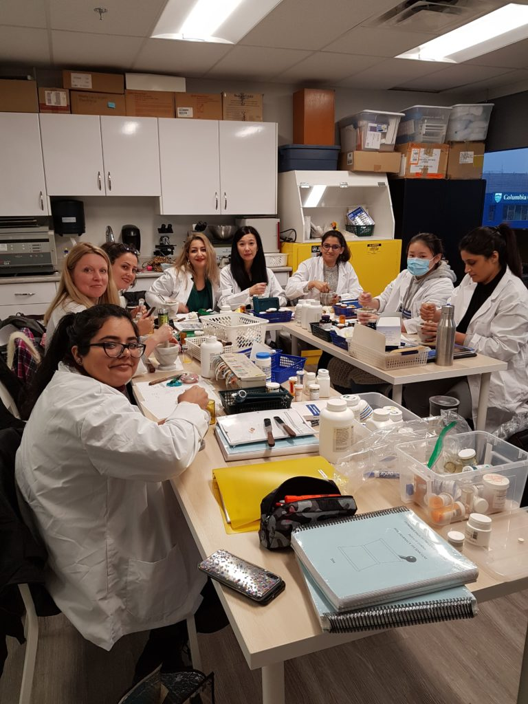 pharamacy assistant college students sprott shaw college in pharmacy lab learning hands-on prescription pills