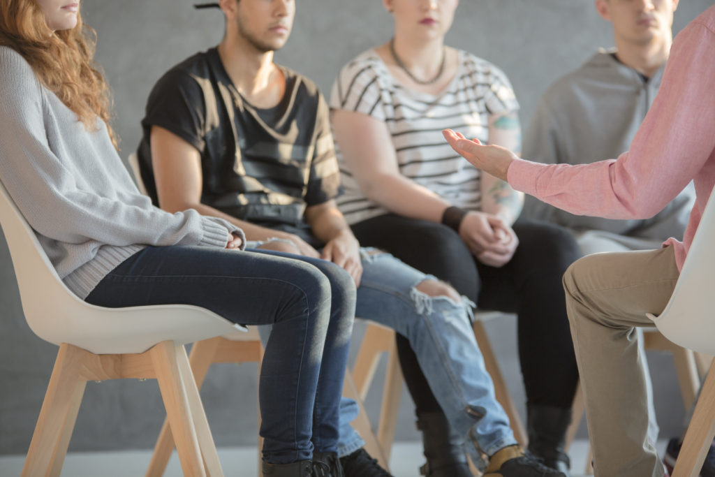 Rebellious youth being treated at a psychotherapy meeting professional counsellor program